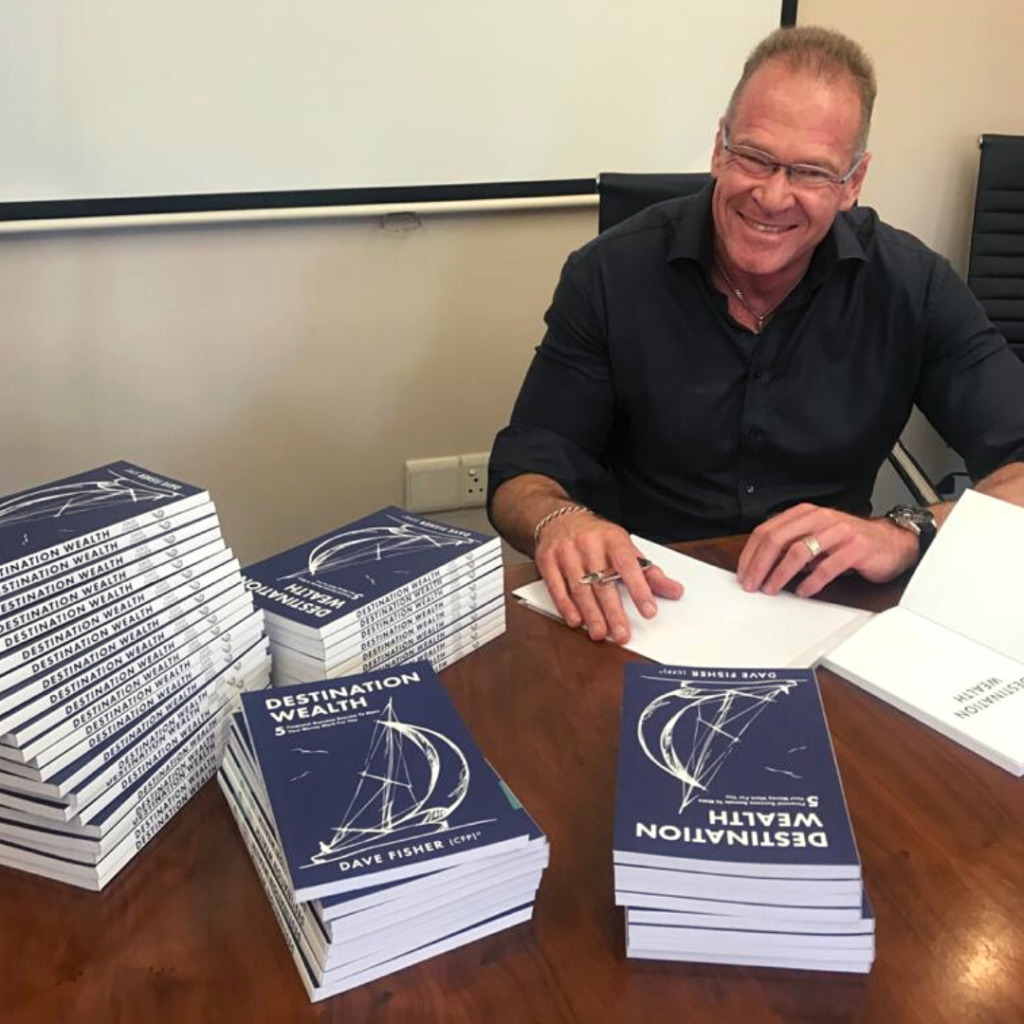 Dave Fisher signing copies of his book, Destination Wealth.